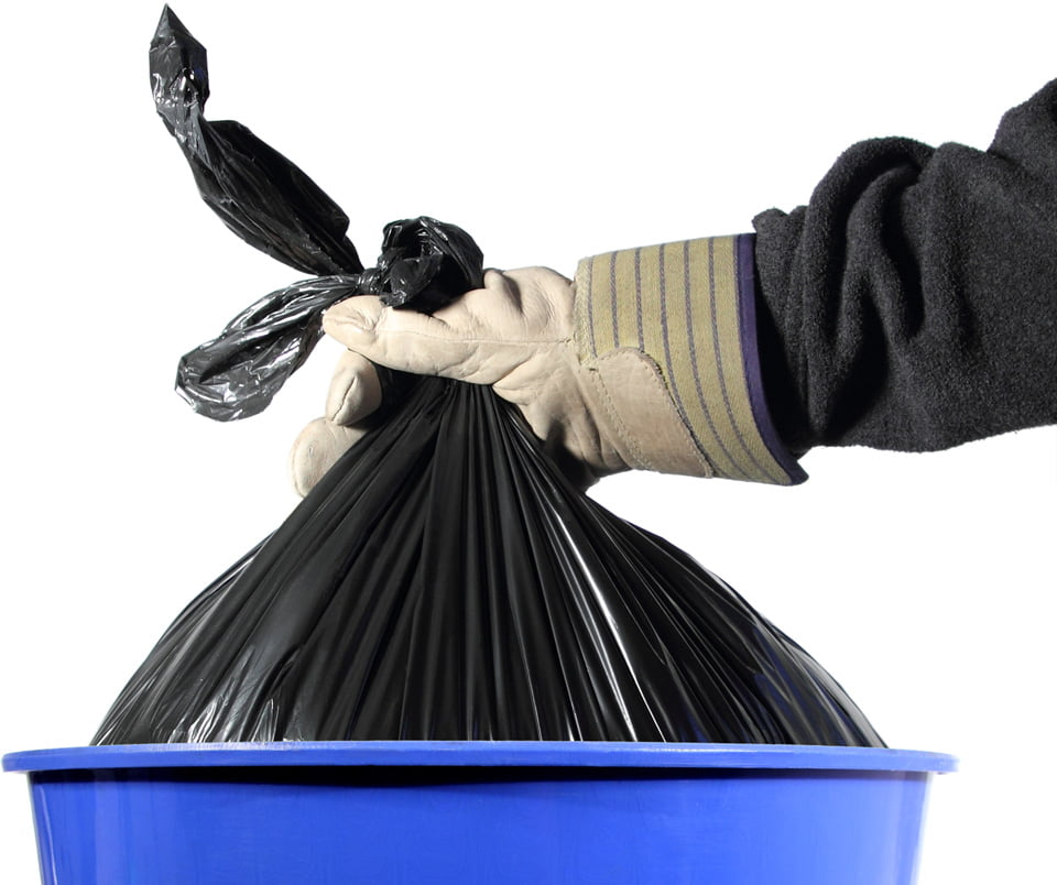 Image of a garbage bag being lifted from a bin.
